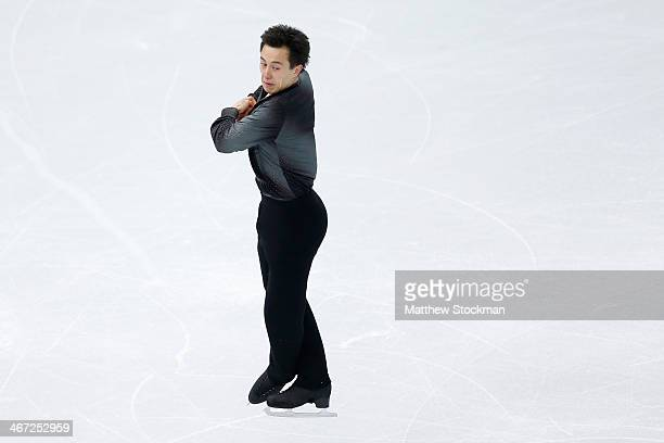 Patrick Chan of Canada competes in the Figure Skating Men's Short Program during the Sochi 2014 Winter Olympics at Iceberg Skating Palace on February...