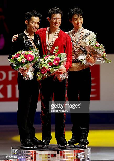 Patrick Chan of Canada , Daisuke Takahashi of Japan and Yuzuru Hanyu of Japan pose for photographs after receiveing their medals during day six of...