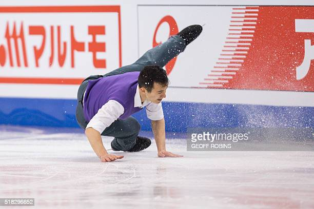 Patrick Chan of Canada falls during his short program in the Men's Competition at the ISU World Figure Skating Championships at TD Garden in Boston...