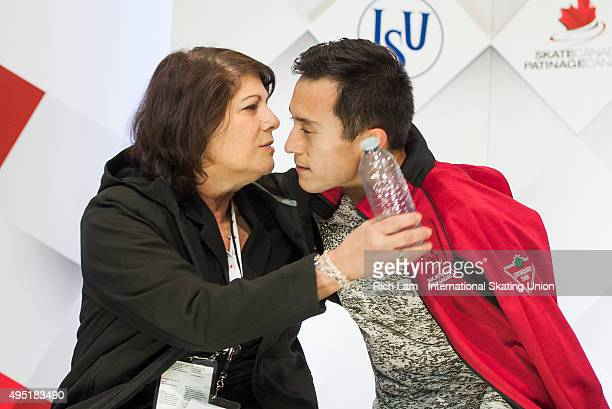 Patrick Chan of Canada is hugged by his coach Kathy Johnson after seeing his score in the Men Free Skate on day two of Skate Canada International ISU...