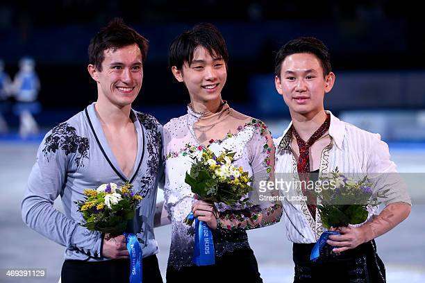 Patrick Chan of Canada poses after winning the silver Yuzuru Hanyu of Japan after winning the gold and Denis Ten of Kazakhstan after winning the...