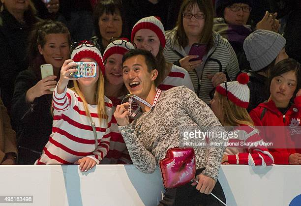 Patrick Chan of Canada poses for a selfie with fans after winning the Men's competition on day two of Skate Canada International ISU Grand Prix of...