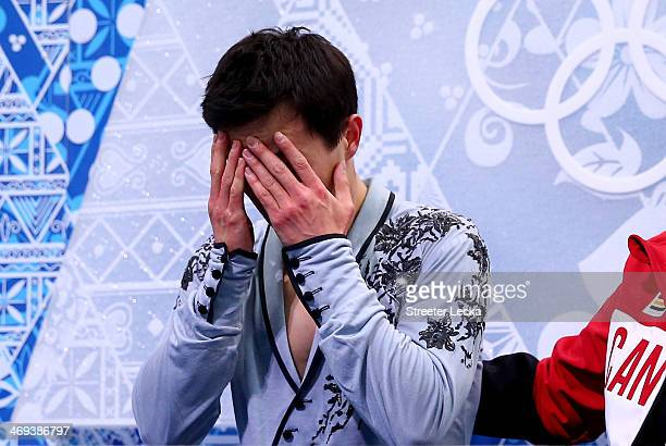 Patrick Chan of Canada reacts after he competes during the Figure Skating Men's Free Skating on day seven of the Sochi 2014 Winter Olympics at...
