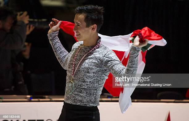 Patrick Chan of Canada skates with the Canadian flag after winning the Men's competition on day two of Skate Canada International ISU Grand Prix of...