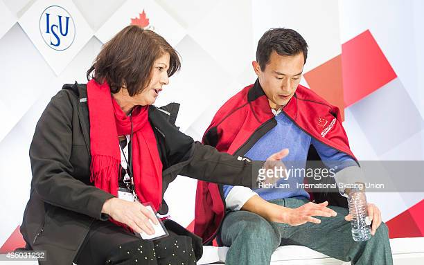 Patrick Chan of Canada with his coach Kathy Johnson after skating the Men's Short Program on day one of Skate Canada International ISU Grand Prix of...