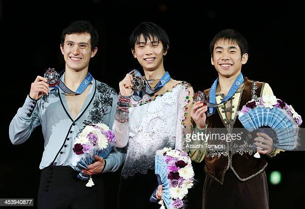 Patrick Chan of Canada Yuzuru Hanyu of Japan and Nobunari Oda of Japan stands on the podium for the men's singles award ceremony during day two of...