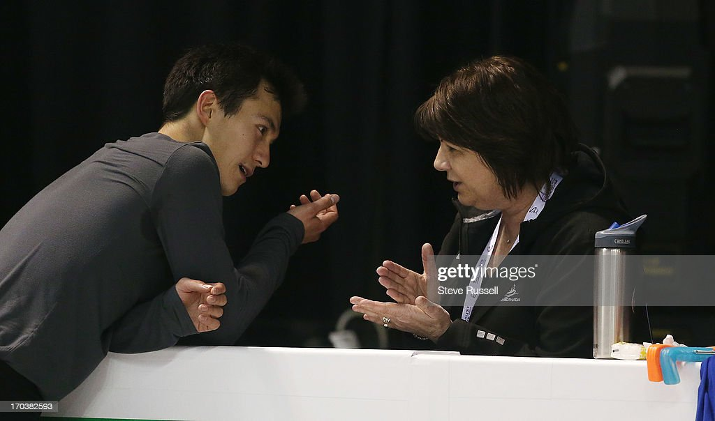 Patrick Chan talks with coach Kathy Johnson as he practices his short program as skaters prepare to compete in the ISU World Figure Skating Championships at Budwieser Gardens.