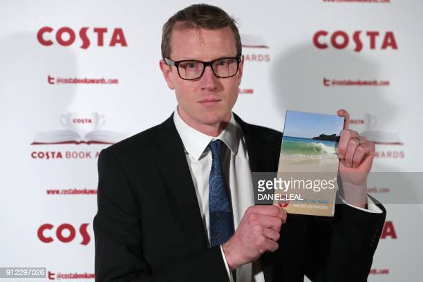Patrick Charnley son of the late British poet and author Helen Dunmore poses with Helen's 'Poetry' Award winning book 'Inside the Wave' as he arrives...