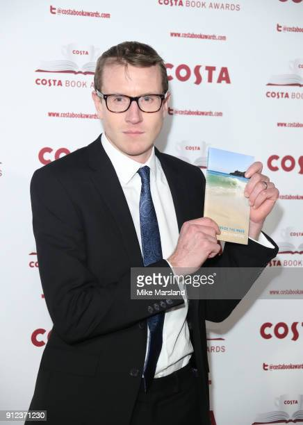 Patrick Charnley with his mother's Helen Dunmore nomanated book Inside the Wave attends the 'Costa Book Awards' 2018 at Quaglinoâ™s on January 30...