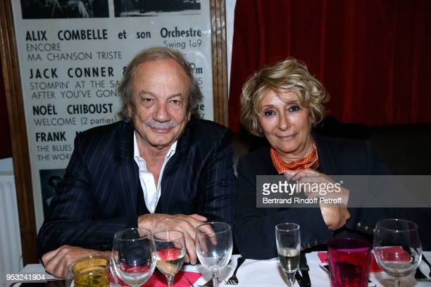 Patrick Chesnais and his wife Josiane Stoleru attend the Dinner in honor of Nathalie Baye at La Chope des Puces on April 30 2018 in SaintOuen France