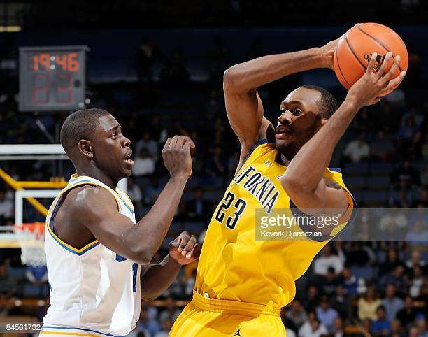 Patrick Christopher of the University of California Golden Bears looks to pass against the defense of Jrue Holiday of the UCLA Bruins during the...