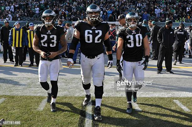 Patrick Chung Jason Kelce and Colt Anderson of the Philadelphia Eagles walk out for the coin toss before to game against the Arizona Cardinals at...