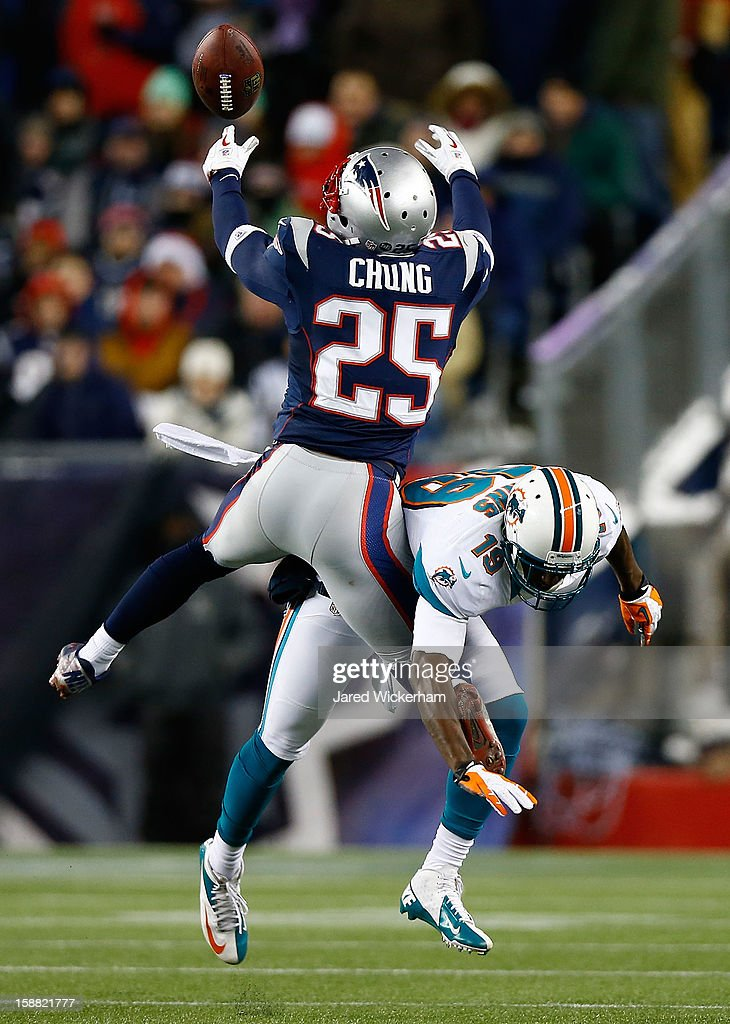 Patrick Chung #25 of the New England Patriots breaks up a pass in front of Armon Binns #19 of the Miami Dolphins in the second half during the game at Gillette Stadium on December 30, 2012 in Foxboro, Massachusetts.