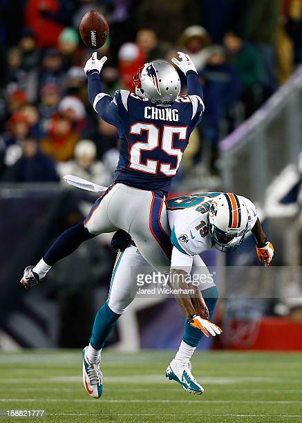 Patrick Chung of the New England Patriots breaks up a pass in front of Armon Binns of the Miami Dolphins in the second half during the game at...