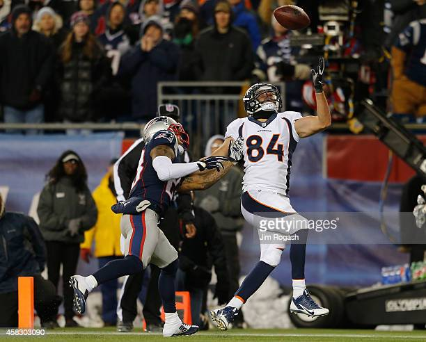 Patrick Chung of the New England Patriots breaks up a pass intended for Jacob Tamme of the Denver Broncos during the fourth quarter at Gillette...