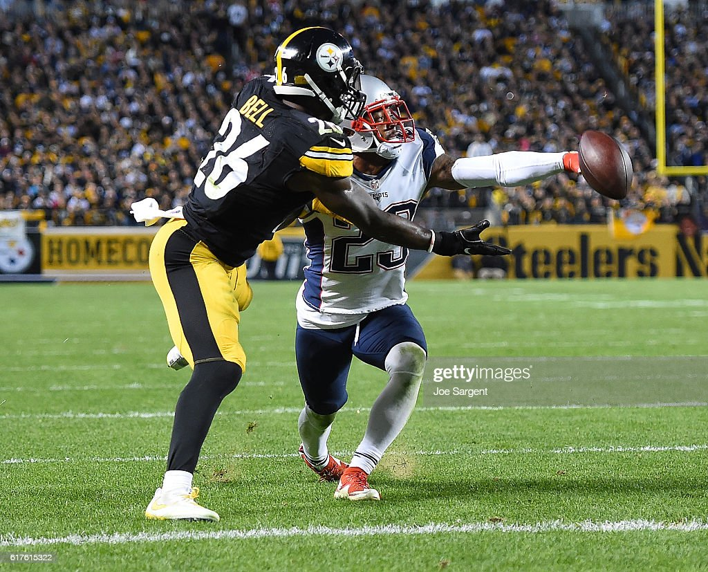 Patrick Chung #23 of the New England Patriots breaks up a pass intended for Le'Veon Bell #26 of the Pittsburgh Steelers in the second half during the game at Heinz Field on October 23, 2016 in Pittsburgh, Pennsylvania.