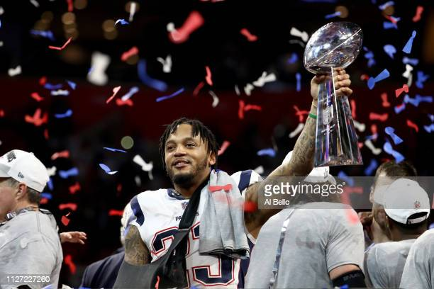 Patrick Chung of the New England Patriots celebrates with the Vince Lombardi Trophy after his teams 133 win over the Los Angeles Rams during Super...