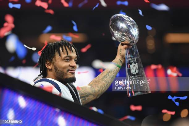 Patrick Chung of the New England Patriots holds the Vince Lombardi Trophy after the New England Patriots won the Super Bowl LIII against the Los...