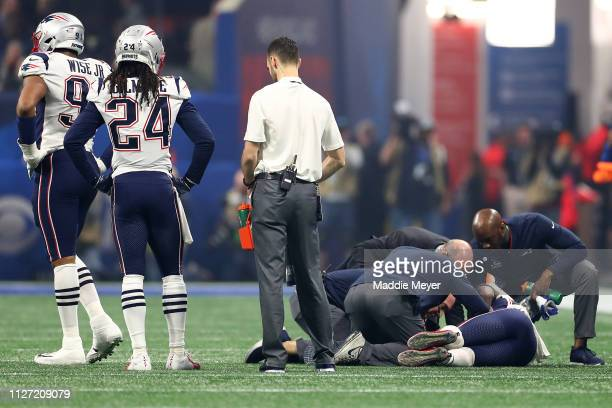Patrick Chung of the New England Patriots is looked at by the trainers in the third quarter against the Los Angeles Rams during Super Bowl LIII at...