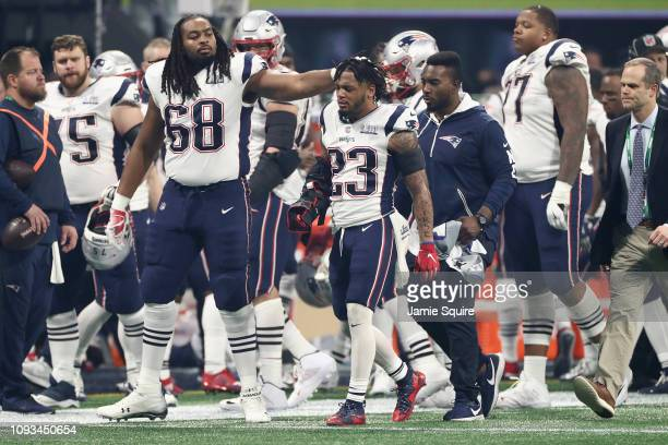 Patrick Chung of the New England Patriots leaves the field after being injured in the third quarter during Super Bowl LIII against the Los Angeles...