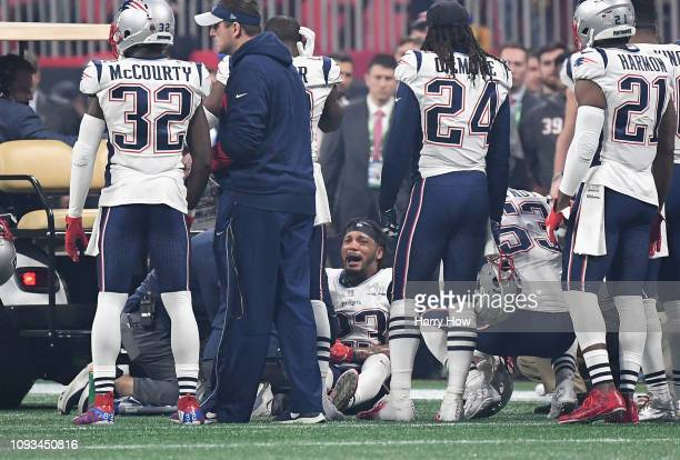 Patrick Chung of the New England Patriots reacts on the ground after getting injured in the second half during Super Bowl LIII against the Los...