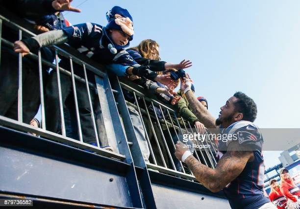 Patrick Chung of the New England Patriots signs autographs after a game against the Miami Dolphins at Gillette Stadium on November 26 2017 in Foxboro...