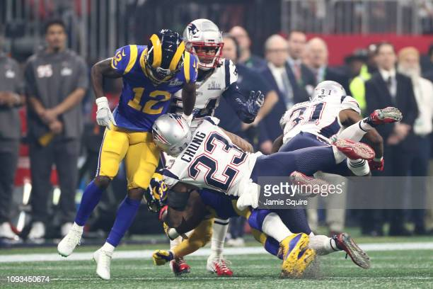Patrick Chung of the New England Patriots tackles Todd Gurley II of the Los Angeles Rams in the second half during Super Bowl LIII at MercedesBenz...