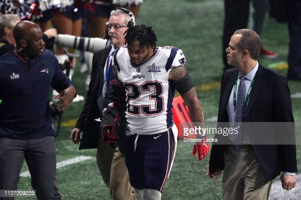 Patrick Chung of the New England Patriots walks off the field after sustaining an injury in the third quarter against the Los Angeles Rams during...
