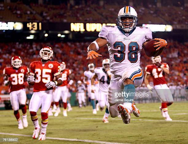 Patrick Cobbs of the Miami Dolphins high steps into the endzone for a touchdown during the 4th quarter of the preseason game against the Kansas City...
