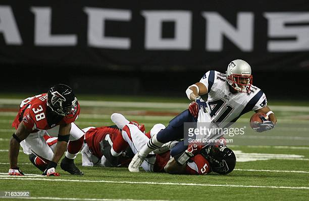 Patrick Cobbs of the New England Patriots is tackled by Martin Patterson of the Atlanta Falcons at the Georgia Dome on August 11, 2006 in Atlanta,...
