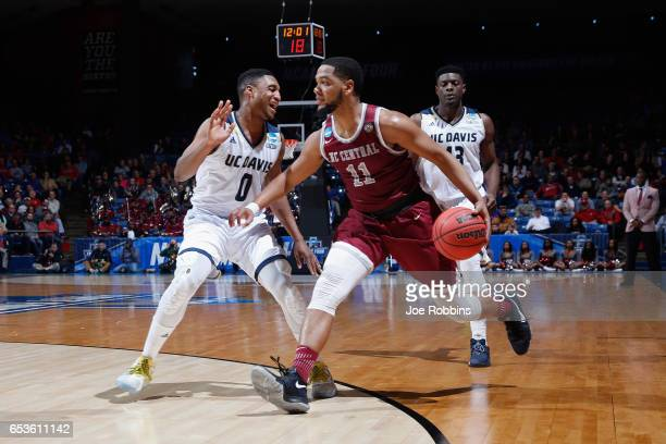 Patrick Cole of the North Carolina Central Eagles dribbles against Brynton Lemar and JT Adenrele of the UC Davis Aggies in the first half during the...