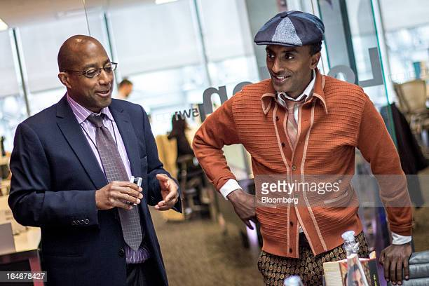 Patrick Cole reporter for the arts and culture team at Bloomberg News left shares a laugh with Marcus Samuelsson owner and chef of Red Rooster Harlem...