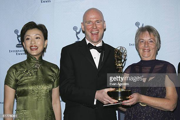 Patrick Collerton and Edna Kennedy pose with the International Emmy Award for Best Documentary for their film 'The Boy Whose Skin Fell Off' for...