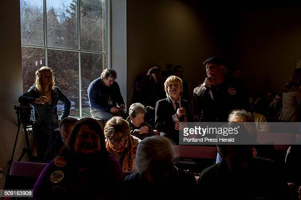 Patrick Conlon and his dad Gerard Conlon at right of Morrill Maine look for the best angle to see Republican presidential candidate Ted Cruz at a...