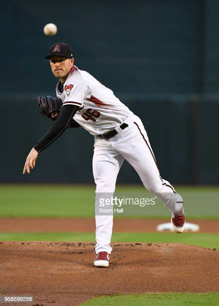 Patrick Corbin of the Arizona Diamondbacks delivers a warm up pitch during a game against the Milwaukee Brewers at Chase Field on May 14 2018 in...