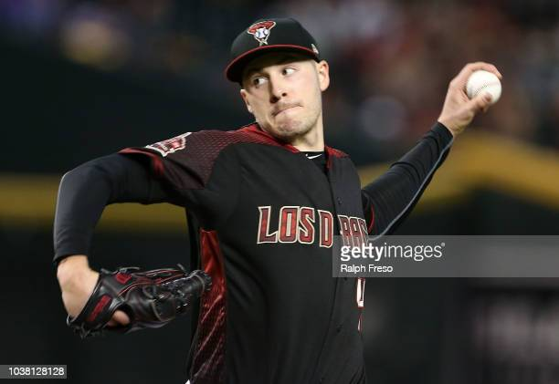 Patrick Corbin of the Arizona Diamondbacks pitches against the Colorado Rockies during the first inning of an MLB game at Chase Field on September 22...