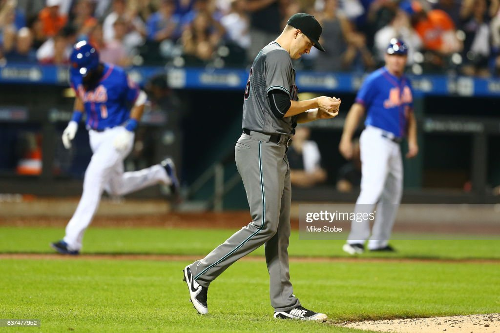 Patrick Corbin #46 of the Arizona Diamondbackslooks on as Amed Rosario #1 of the New York Mets rounds third base after hitting a solo home run in the fifth inning at Citi Field on August 22, 2017 in the Flushing neighborhood of the Queens borough of New York City.