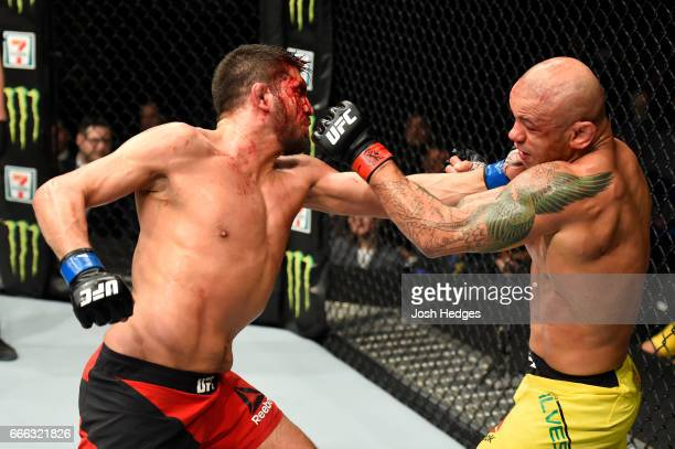 Patrick Cote of Canada lands a punch on Thiago Alves of Brazil in their welterweight bout during the UFC 210 event at KeyBank Center on April 8 2017...
