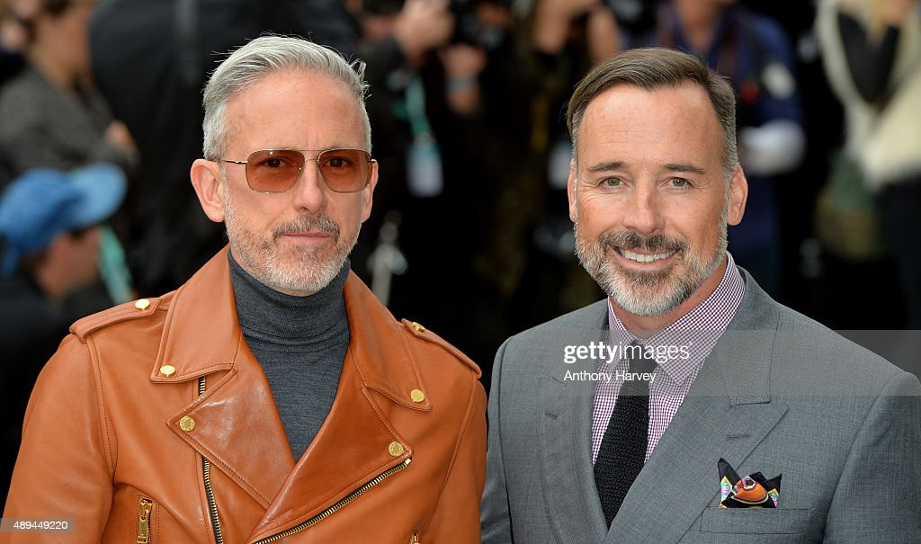 Patrick Cox and David Furnish attend the Burberry Prorsum show during London Fashion Week Spring/Summer 2016/17 on September 21, 2015 in London, England.