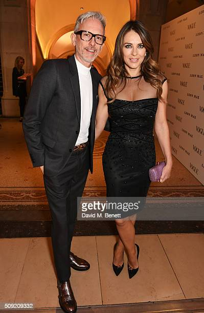 Patrick Cox and Elizabeth Hurley attend a private view of 'Vogue 100 A Century of Style' hosted by Alexandra Shulman and Leon Max at the National...