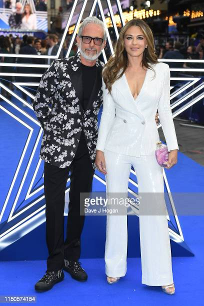 Patrick Cox and Elizabeth Hurley attend the Rocketman UK premiere at Odeon Leicester Square on May 20 2019 in London England