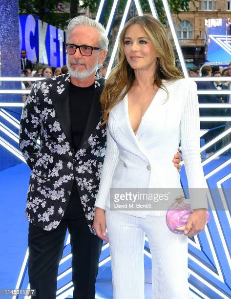 Patrick Cox and Elizabeth Hurley attend the UK Premiere of Rocketman at Odeon Luxe Leicester Square on May 20 2019 in London England