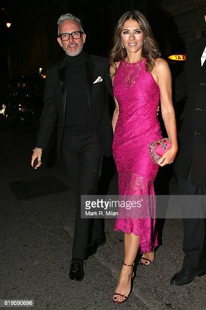 Patrick Cox and Elizabeth Hurley attending the Harper's Bazaar Women of the Year Awards on October 31 2016 in London England