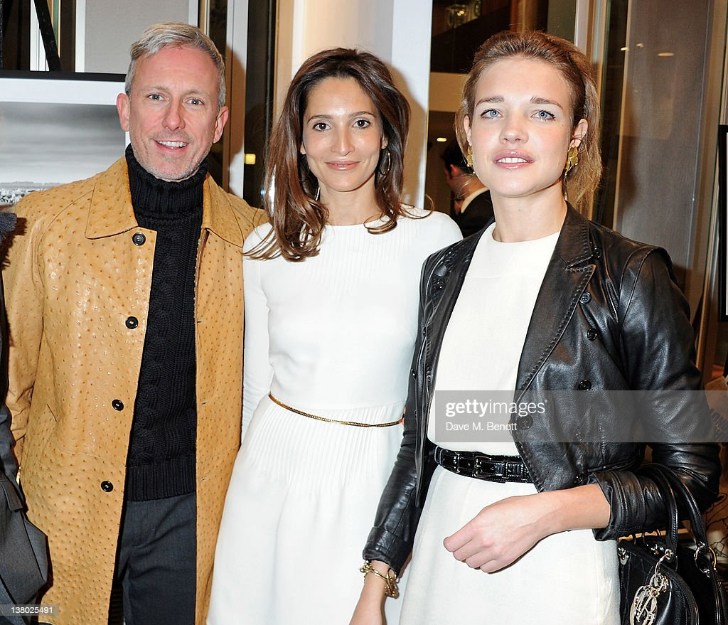 Patrick Cox, Astrid Munoz and Natalia Vodianova attend a private viewing of 'Gaucho', a photographic exhibition by Astrid Munoz, at the Jaeger-LeCoultre Boutique on January 31, 2012 in London, England.