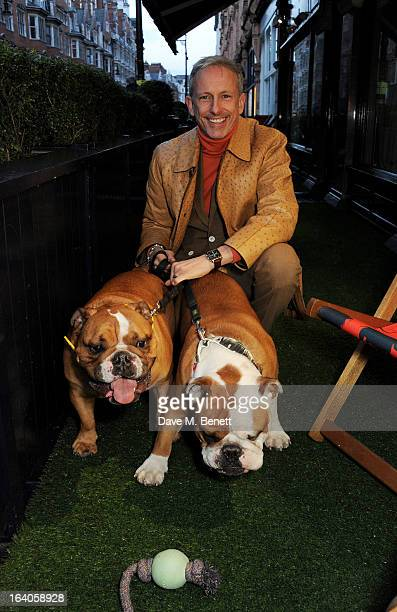 Patrick Cox attends Dine for Dogs Trust launching a dog friendly menu at The George Club on March 19 2013 in London England