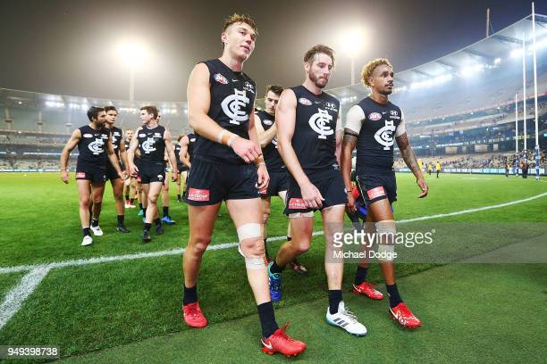 Patrick Cripps Dale Thomas and Jarrod Garlett of the Blues look dejected after defeat during the round five AFL match between the Carlton Blues and...