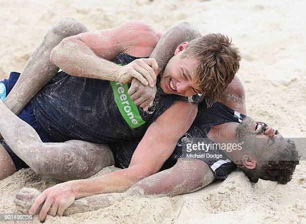Patrick Cripps is caught in a headlock by Clem Smith in a wrestle during a circuit training session at Kurrawa Beach during the Carlton Blues AFL...
