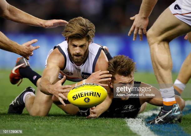 Patrick Cripps of the Blues and Callan Ward of the Giants compete for the ball during the 2018 AFL round 20 match between the Carlton Blues and the...
