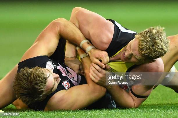 Patrick Cripps of the Blues and Josh Caddy of the Tigers wrestle during the round one AFL match between the Richmond Tigers and the Carlton Blues at...