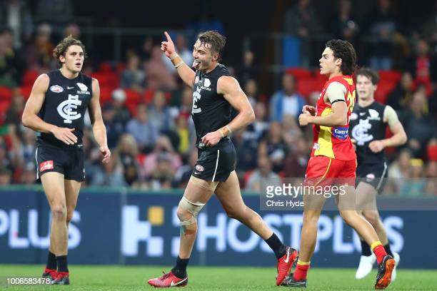 Patrick Cripps of the Blues celebrates a goal during the round 19 AFL match between the Gold Coast Suns and the Carlton Blues at Metricon Stadium on...
